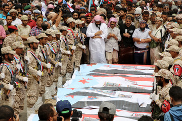 Yemen's southern separatists pray during a funeral of Brigadier General Muneer al-Yafee and his comrades killed in a Houthi missile attack, in Aden
