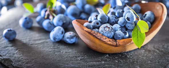 Freshly Picked Blueberries on Dark Slate Background