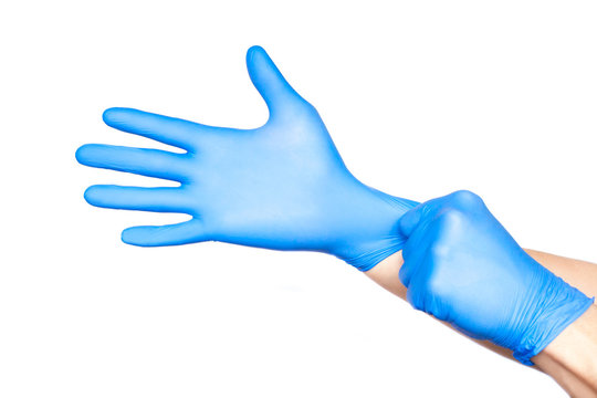 Doctor putting on gloves isolated on white