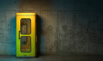 Single old yellow phone booth in retro style standing on the floor in front of the concrete wall at night time. Gloomy poorly lit interior in loft style with copy space. 3D rendering