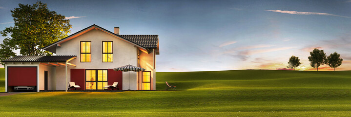 Evening view of a modern house with a lawn and a terrace.