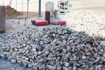 construction of pavement road with cobblestone granite