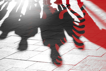 Albanian Flag and Shadows of People as citizens of Country, conceptual Picture