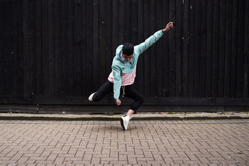 Young man dancing on the street