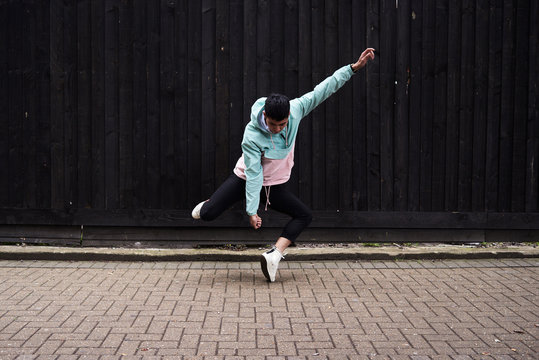 Young man dancing on street