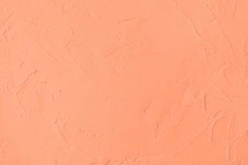 Light orange colored low contrast Concrete textured background with roughness and irregularities to...