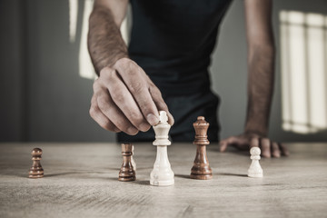 man playing chess on the desk