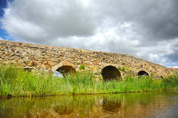 Roman bridge over the Ayuela river in  Casas de Don Antonio village in the  province of Caceres Extremadura Spain. Here cross the Via de la Plata towards Santiago de Compostela.
