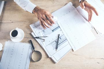 man hand documents on desk