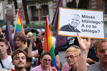 """People protest after Polish bishop likens LGBT+ rainbow flag to """"communist plague"""" in Warsaw"""