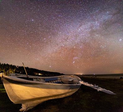 Wooden rusty boat under stars