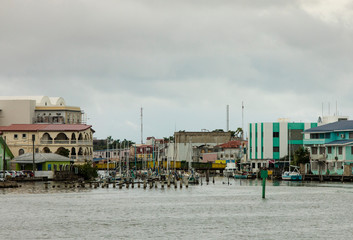 The port of Belize City seen from the water on a cloudy day.