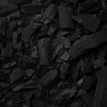 Black charcoal background for preparing grill food