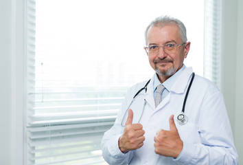 Cheerful doctor showing thumbs up satisfaction sign