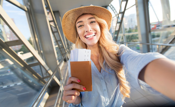 Enjoy traveling. Beautiful woman taking selfie in airport