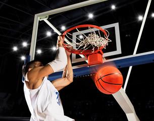 Man basketball player. Dunk. Number 23