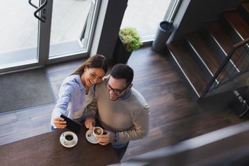 Couple taking a selfie in a coffee shop