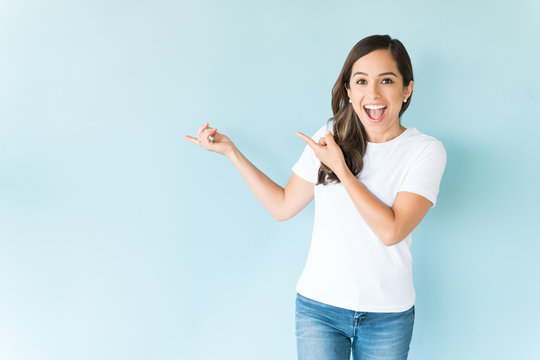 Cheerful Woman Pointing Against Isolated Background