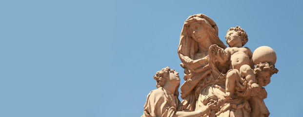 Ancient baroque statues of St Anne on the Charles' bridge. Prague, Czech Republic. Wall mural