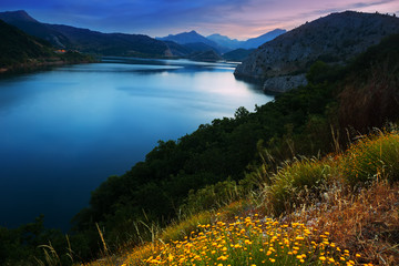 mountains reservoir  in summer twilight
