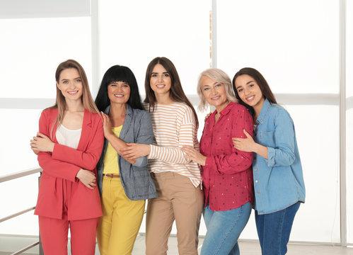 Group of ladies near window indoors. Women power concept
