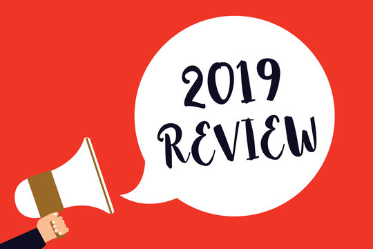 Handwriting text 2019 Review. Concept meaning seeing important events or actions that made previous year Man holding megaphone loudspeaker speech bubble screaming red background