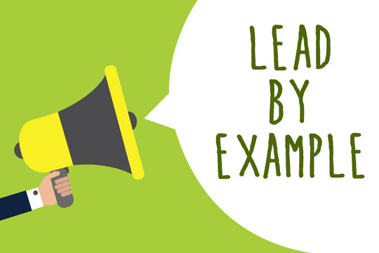 Conceptual hand writing showing Lead By Example. Business photo showcasing Be a mentor leader follow the rules give examples Coach Man holding loudspeaker speech bubble message speaking loud