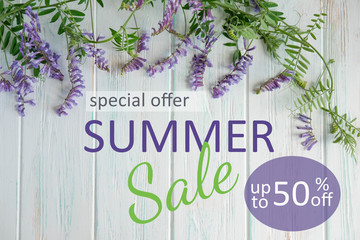 Banner summer sale. Summer wildflowers with the inscription summer sale on a wooden background. Promotion, discount, sale