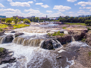 Low aerial view of the waterfall in Sioux Falls, South Dakota's largest city. Wall mural