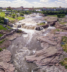 Low aerial view of the waterfall and Falls Park in Sioux Falls, South Dakota.