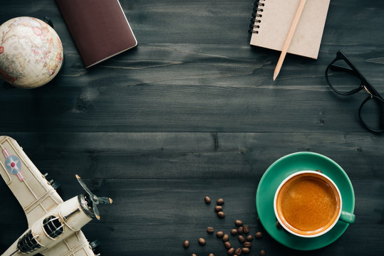 Preparation for Traveling concept, passport, money bag,notebook,coffee,map on a wooden background. with copy space
