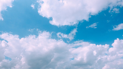 Beautiful bright blue sky with white fluffy clouds on a clear sunny day. Royalty high-quality free stock photo image of blue sky with white cloud, nice weather. Photo of natural cloudscape background