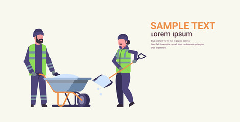 workers couple in uniform using shovel and wheelbarrow winter snow removal concept woman man working together cleaning service flat full length horizontal copy space