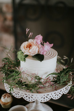 Small White Wedding Cake with flowers on top, peonies on wedding cake