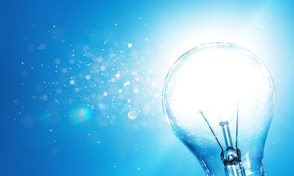 Standard Incandescent Light Bulb on Blue Background