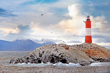 Panormaic view of the Les Eclaireurs Lighthouse, on the Beagle Channel in Ushuaia, Tierra del Fuego, surrounded by a warm sunset sky.