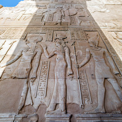 Relief depicting the ancient Egyptian gods and hieroglyphs in the temple of Kom Ombo, Egypt