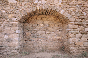 Archway in a stone wall