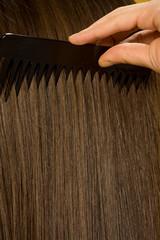 Closeup of woman combing her hair