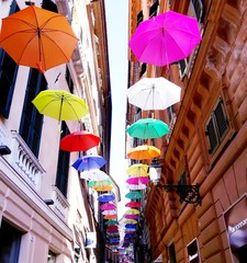 Bright abstract background of jumble of rainbow colored umbrellas over the city celebrating gay pride