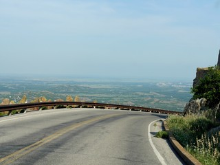 Sharp curve in the road from the peak of Mt Scott in Oklahoma, USA.