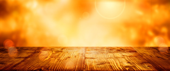 Wooden table with blurred golden bokeh background
