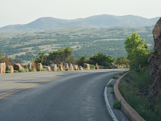 Paved curved road coming down from the peak of Mt Scott in Oklahoma.