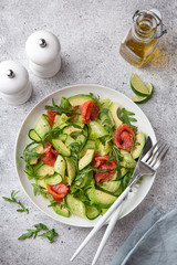 avocado, smoked salmon and cucumber salad on white plate