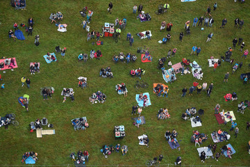 Spectators view balloons during a mass take-off at the annual Bristol hot air balloon festival in Bristol, Britain