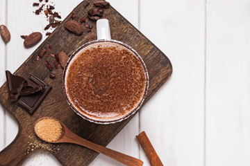Canvas Prints Chocolate Hot chocolate in the cup, cocoa beans and powder on the white wooden table