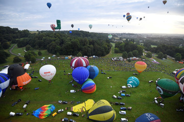 Balloons launch during a mass take off at the annual Bristol hot air balloon festival in Bristol, Britain