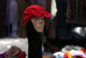 A mannequin displaying hijab is seen at a market ahead of the Eid al-Adha festival, in the central Gaza Strip