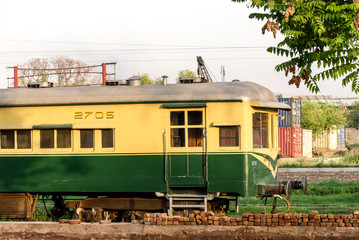 Green and yellow boggy of Pakistan railway trains.