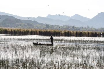 Fisherman casting net at kallar Kahar lake in Punjab Pakistan.